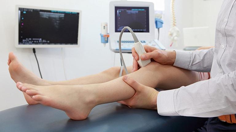 Woman having a leg scan
