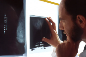 Sonographer looking at a scan